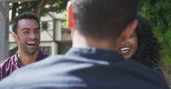 Hipster friends talking and laughing together at outdoor caf_ Stock Footage