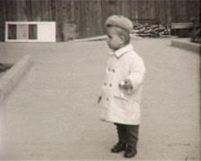 Child steps on the street (Vintage 8mm Film Home Movie) - stock footage