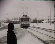 Tram rides on the street (vintage 8mm film home movie) Stock Footage