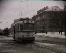Tram rides on the deserted street (vintage 8mm film home movie) Stock Footage