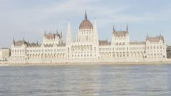 Slow tilting Hungarian parliament building located on river Danube  and city Stock Footage