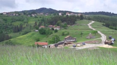 Alpine village with old houses and swaying grasses Stock Footage