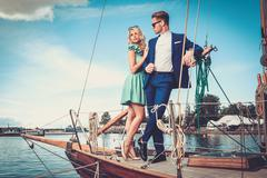 Stock Photo of Stylish wealthy couple on a luxury yacht