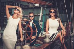 Stylish wealthy friends on a luxury yacht - stock photo