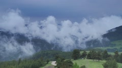 Water vapor moving in the high hills of mountain-timelapse Stock Footage