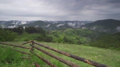 Alpine landscape with meadows and hills covered with mist Stock Footage