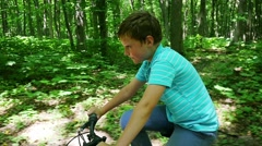 Boy Biking On Forest Trails Slow Motion - stock footage