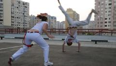 KIEV, UKRAINE – JUNE 23, 2015: Couple Practicing Capoeira Stock Footage