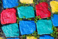 Colourful painted stone paving texture - stock photo