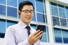 Businessman Talking Video Call On Mobile With Bluetooth Handsfree Stock Photos
