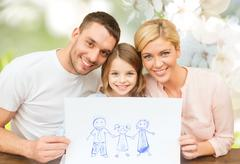 Happy family with drawing or picture Stock Photos