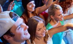 smiling friends at concert in club - stock photo