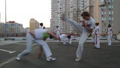 KIEV, UKRAINE – JUNE 23, 2015: Two Men Practicing Capoeira Stock Footage