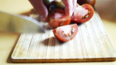 Slicing tomato with japan chef's knife for home side dish preparation. Stock Footage