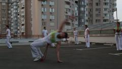 KIEV, UKRAINE – JUNE 23, 2015: Mid Adult Man Performing Capoeira Stunts Stock Footage