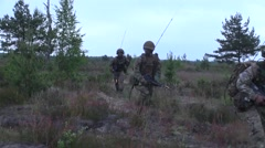 Mock battlefield operations during Operation Saber Strike 2015 Stock Footage