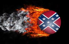Flag with a trail of fire and smoke - Confederate flag Stock Photos