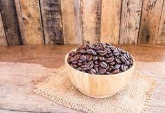 Roasted coffee beans in a wooden bowl Stock Photos