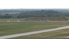 F16 Fighting Falcons along with their Polish counterparts, take off Stock Footage
