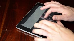 Typing on an Electronic Tablet Stock Footage