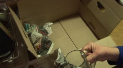 Packing Glasses in Box Stock Footage