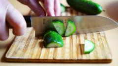 Slicing a cucumber with japanese chef's knife for home side dish preparation. Stock Footage