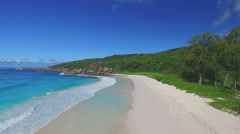 Flying over sandy beach and vegetation of tropical island Stock Footage