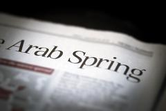 Arab Spring written newspaper. Stock Photos