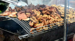 Grilled entrails pork in local market, Thailand Stock Footage