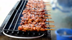 Skewer chicken pieces roasting on the grill and smoke Stock Footage