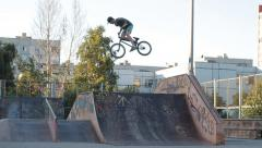 Extreme Sport - Bmx Skatepar rider doing tricks on skate park - stock footage