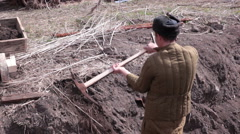 Soviet prisoner digging with a pick Stock Footage
