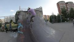 BMX bicycle trick 540 skate park - stock footage