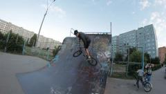BMX bicycle trick 540 skate park - stock footage