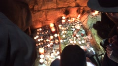 Lighting Memorial Candles - stock footage