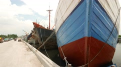 Old wooden ships prow, moorage area of Sunda Kelapa, moving camera Stock Footage