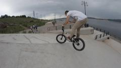 slow motion: Extreme Sport bmx bicycle  trick barspin - stock footage