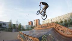 Extreme Sport skatepark bmx bicycle  trick no hand to barspin - stock footage