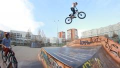Extreme Sport skatepark BMX bicycle trick 360 big air - stock footage