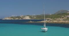 4K, Stunning Emerald Green Mara Beach with Sailing Boat Stock Footage