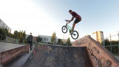 Extreme Sport skatepark bmx trick on fun box Stock Footage