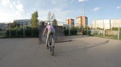 slow motion: Extreme Sport skatepark bmx trick - stock footage
