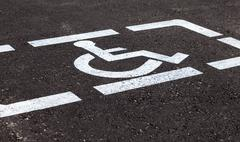 Parking places with handicapped or disabled signs and marking lines on asphal - stock photo