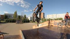 Slow motion: Extreme Sport skatepark bmx trick barspin 360 Stock Footage