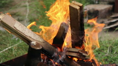 Wood burns in the grill outdoors, firewood burning in the fire Stock Footage