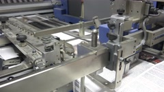 Folding machine STEADYCAM folds printed offset sheet as part of newspaper bro Stock Footage