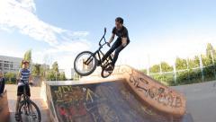 Extreme Sport skatepark BMX trick bar on manual - stock footage