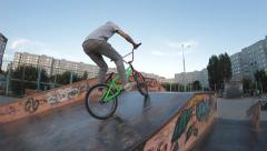 Extreme Sport skatepark BMX bicycle trick 180 drop - stock footage
