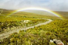 High Altitude Road With Rainbow In Andes Mountains Stock Photos