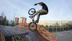 Slow motion: Extreme Sport skate BMX trick no hand to barspin skate park Stock Footage